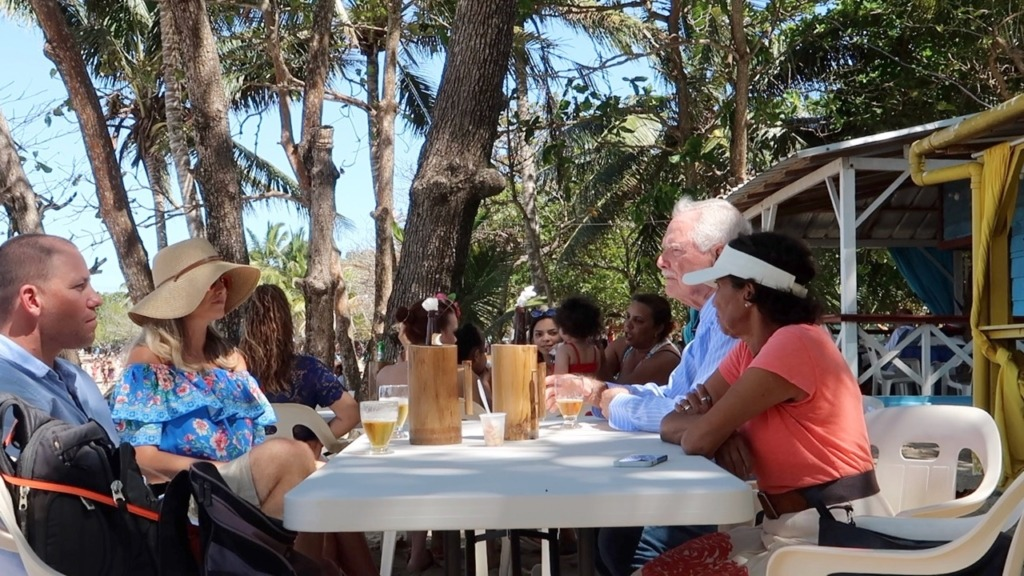 picture of 4 people having lunch at a beach restaurant