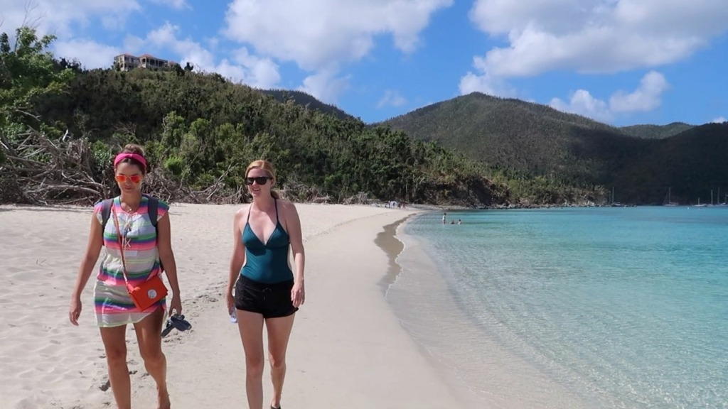 girls walking on beach in St. John USVI - Sailing Satori