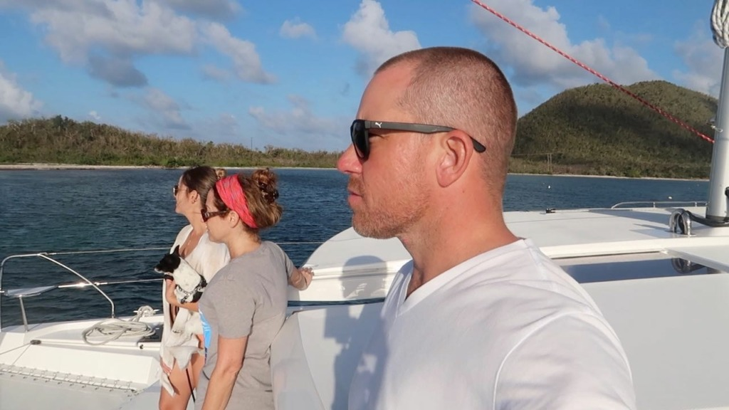 photo of Nick Kelly and Adrianne on a Catamaran in the BVI