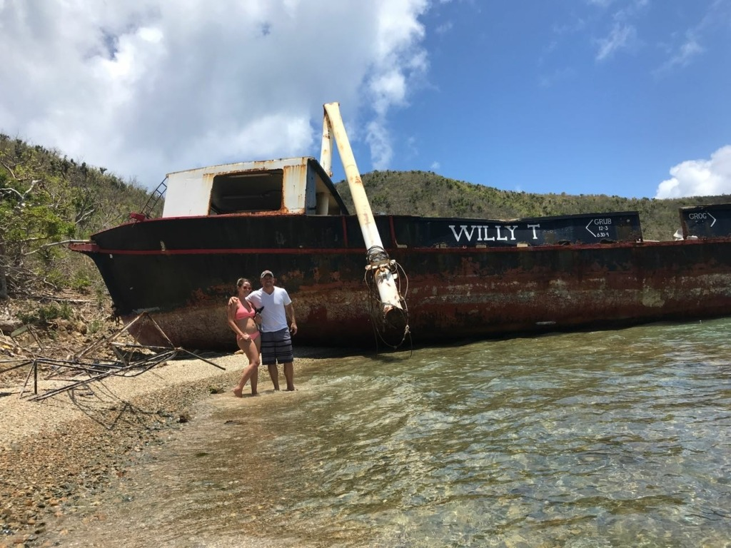 the old Willy-T floating bar washed ashore at the bight in norman island