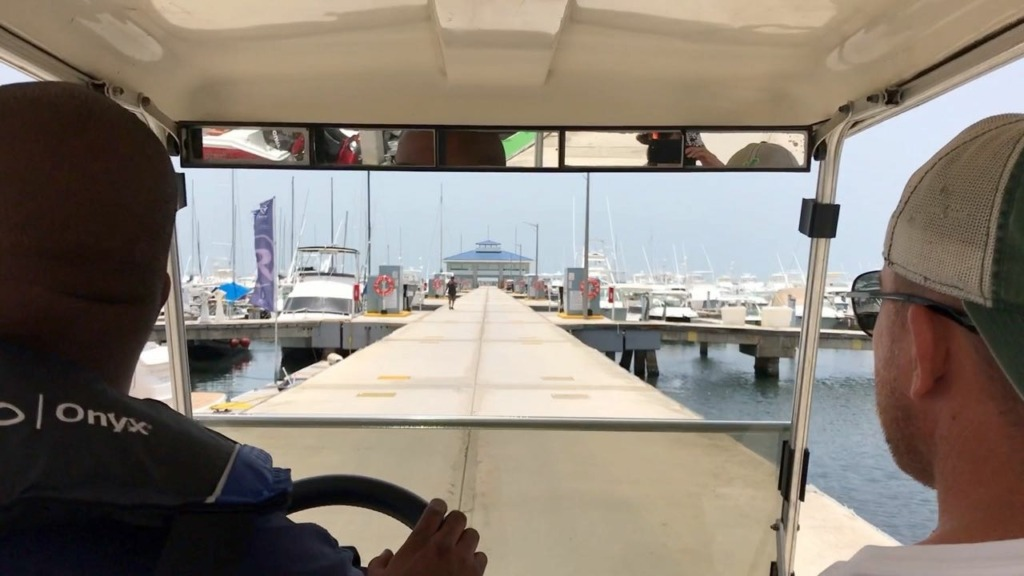 Puerto Del Rey Marina Review - view from inside golf cart shuttle sailing satori